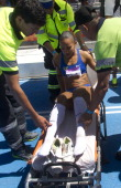 Brazilian Keila Da Silva is taken off on a stretcher after winning the women's long jump final during the X South American Games at the Estadio...