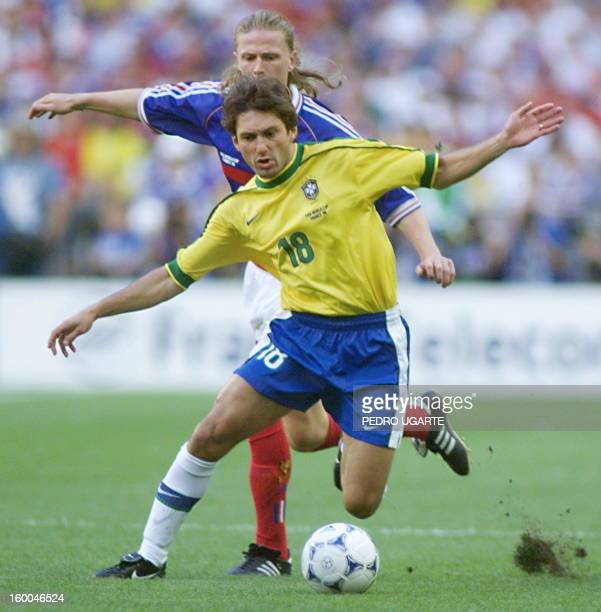 Brazilian Leonardo is challenged by French Emmanuel Petit 12 July at the Stade de France in SaintDenis during the 1998 World Cup final between Brazil...