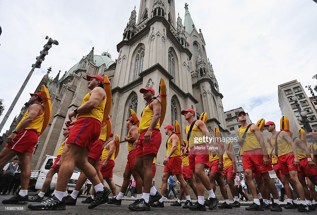 Brazilian lifeguards march past Se Cathedral, the cathedral of the Roman Catholic Archbishop of Sao Paulo, Cardinal Odilo Pedro Scherer, during a ceremony celebrating the 133rd anniversary of the Sao Paulo Fire Department, on March 13, 2013 in Sao Paulo, Brazil. Brazil has more Catholics than any other country in the world and supporters hope Sao Paulo Archbishop Cardinal Odilo Pedro Scherer will be chosen as the next Pope during the papal conclave.