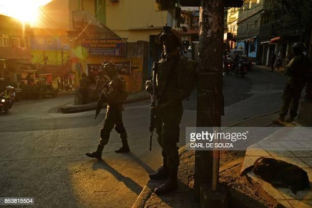 TOPSHOT Brazilian marines stand guard in Rocinha favela in Rio de Janeiro on September 25 2017 Security officials said the giant Rocinha favela in...