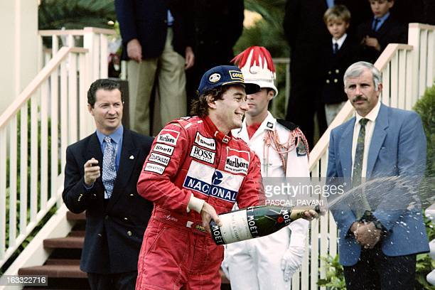 Brazilian McLaren Ford driver Ayrton Senna sprays champagne after winning the Monaco Formula One Grand Prix on May 23 1993 Senna won for the fifth...