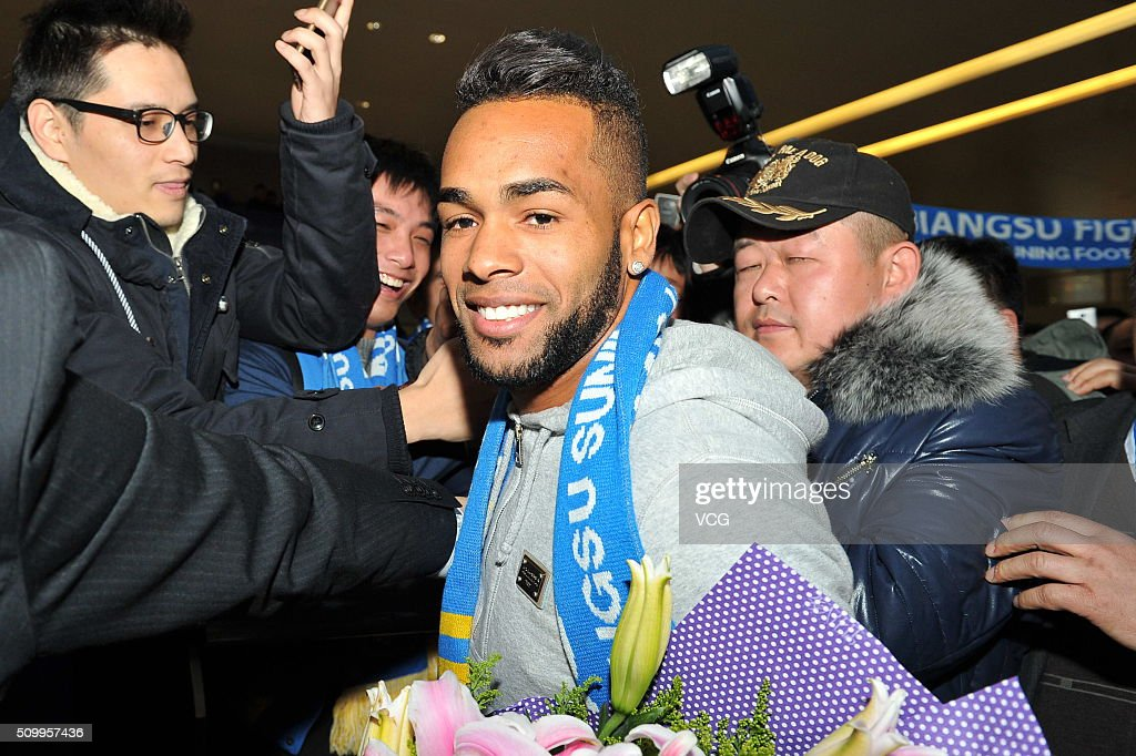 Brazilian midfielder <a gi-track='captionPersonalityLinkClicked' href=/galleries/search?phrase=Alex+Teixeira&family=editorial&specificpeople=6016416 ng-click='$event.stopPropagation()'>Alex Teixeira</a> arrives at Nanjing Lukou International Airport on February 13, 2016 in Nanjing, China. <a gi-track='captionPersonalityLinkClicked' href=/galleries/search?phrase=Alex+Teixeira&family=editorial&specificpeople=6016416 ng-click='$event.stopPropagation()'>Alex Teixeira</a> has signed a four-year contract with Chinese Super League club Jiangsu Suning.