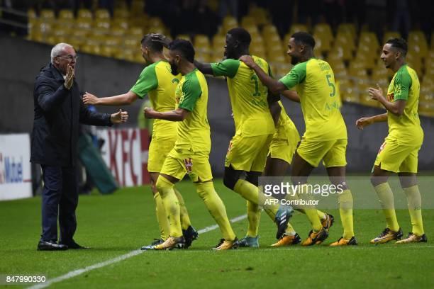 Brazilian midfielder Andrei Girotto celebrates with Nantes' Italian head coach Claudio Ranieri after scoring a goal during the French L1 football...