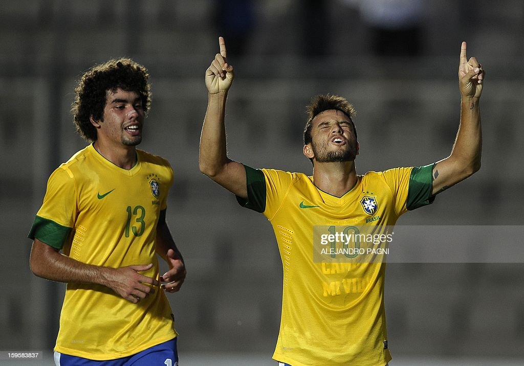Brazilian midfielder Felipe Anderson (R) celebrates next to teammate forward Bruno after scoring a goal against Venezuela during their South American U-20 Championship Group B qualifier football match, at the Bicentenario stadium in San Juan, Argentina, on January 16, 2013. Four South American teams will qualify for the FIFA U-20 World Cup Turkey 2013.