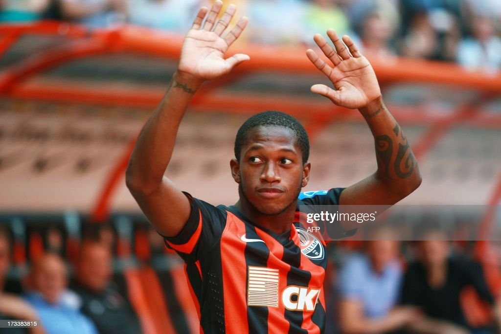 Brazilian midfielder Fred greets fans in Donetsk during his official presentation at the football team FC Shakhtar on July 12 2013 in Donetsk Fred...