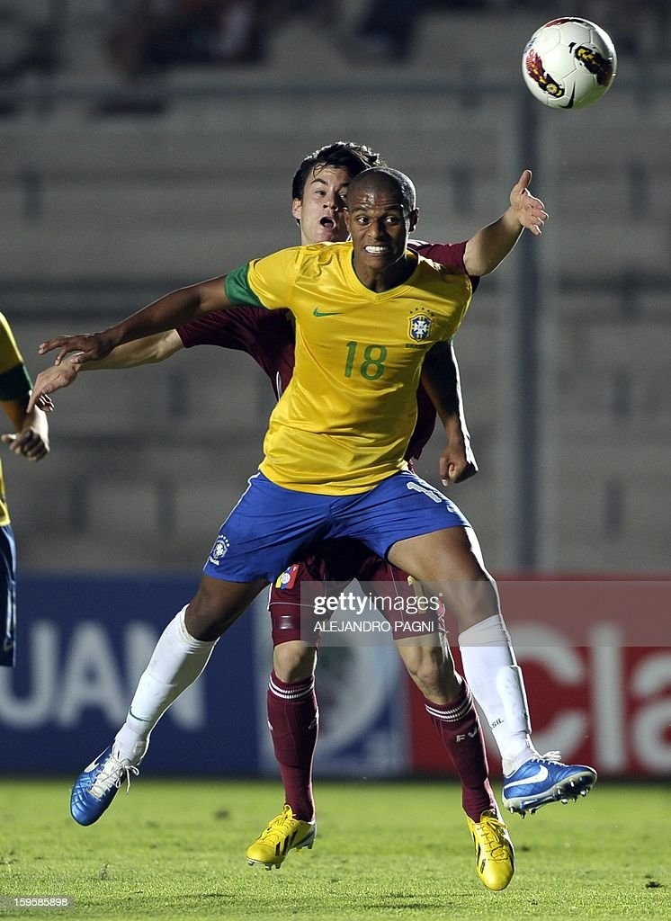 Brazilian midfielder Lucas Candido (front) heads the ball past Venezuelan midfielder Juan Anor during their South American U-20 Championship Group B qualifier football match, at the Bicentenario stadium in San Juan, Argentina, on January 16, 2013. Four South American teams will qualify for the FIFA U-20 World Cup Turkey 2013.