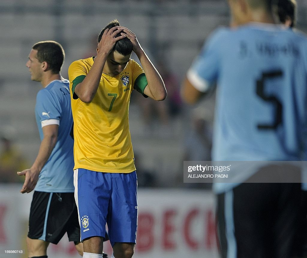 Brazilian midfielder Nico Mattheus (C) reacts after missing a chance at goal against Uruguay during their South American U-20 Championship Group B football match, at Bicentenario stadium in San Juan, Argentina, on January 12, 2013. Four South American teams will qualify for the FIFA U-20 World Cup Turkey 2013.