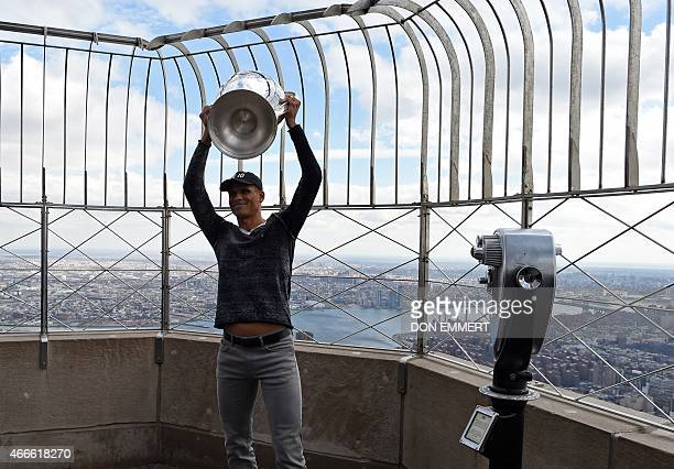 Brazilian midfielder Rivaldo poses for photos with the UEFA Champions League trophy on the 86th floor Observatory of the Empire State Building March...
