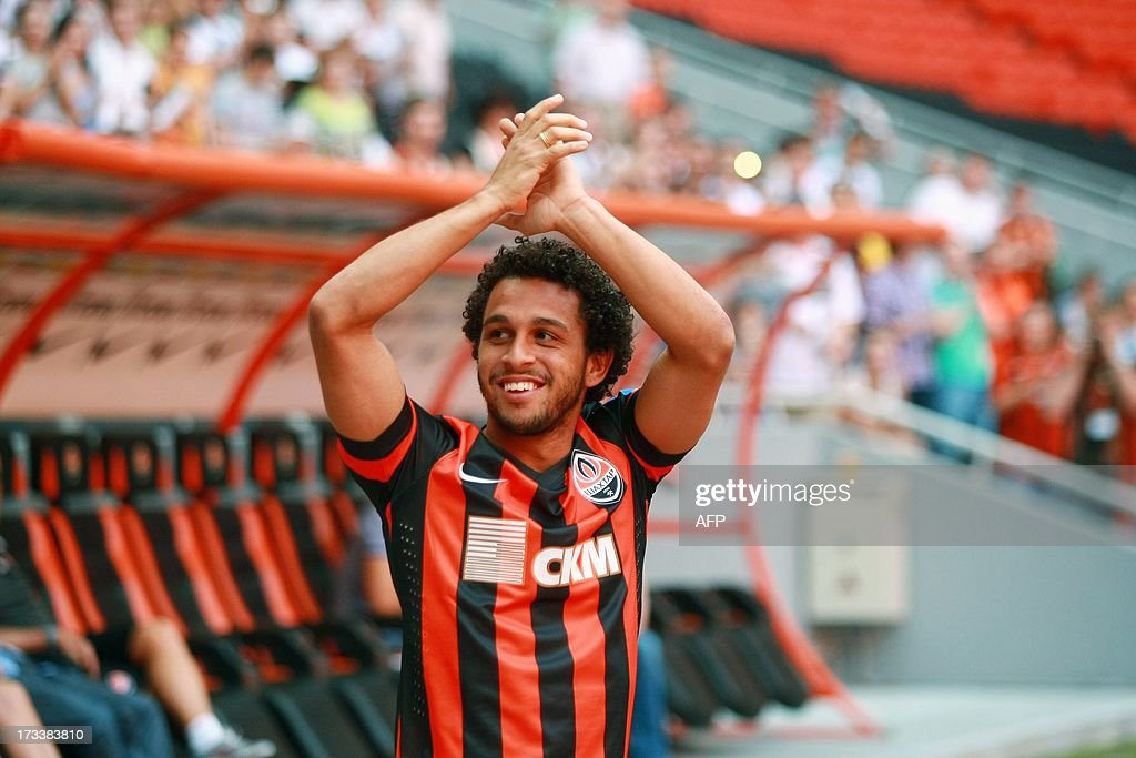 Brazilian midfielder Wellington Nem greets fans during his official presentation at FC Shakhtar in Donetsk on July 12 2013 The former player of...