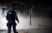 A Brazilian militarized policeman stares at bullet holes at the place of a drugtrafficker at the Mangueirinhas favelas complex in Duque de Caxias 30...