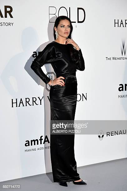 Brazilian model Adriana Lima poses as she arrives for the amfAR's 23rd Cinema Against AIDS Gala on May 19 2016 in Antibes southeastern France / AFP /...