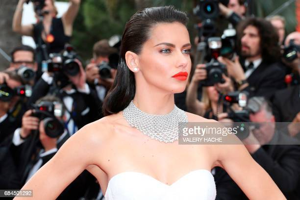 TOPSHOT Brazilian model Adriana Lima poses as she arrives on May 18 2017 for the screening of the film 'Loveless' at the 70th edition of the Cannes...