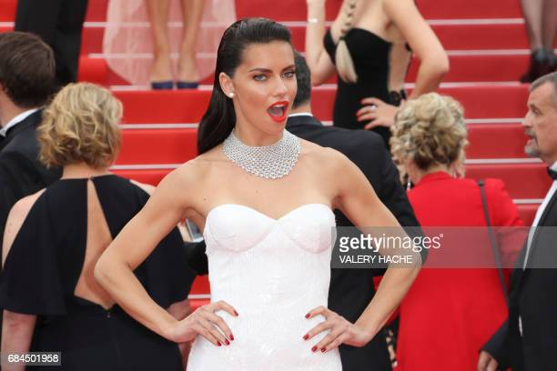 Brazilian model Adriana Lima poses as she arrives on May 18 2017 for the screening of the film 'Loveless' at the 70th edition of the Cannes Film...