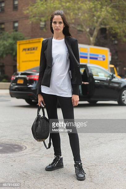 Brazilian model Amanda Wellsh exits the Herve Leger by Max Azria show at Lincoln Center with an Alexander Wang bag and Giuseppe Zanotti sneakers on...