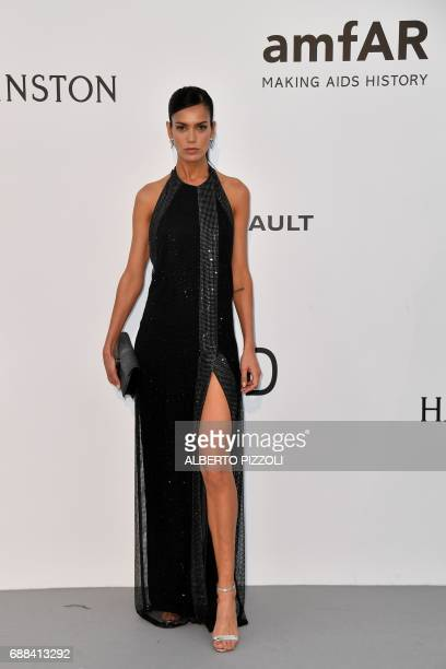 Brazilian model Amanda Wellsh poses as she arrives for the amfAR's 24th Cinema Against AIDS Gala on May 25 2017 at the Hotel du CapEdenRoc in Cap...