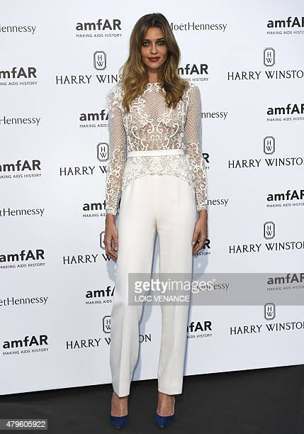 Brazilian model Ana Beatriz Barros arrives for the Amfar dinner on the sidelines of the Paris fashion week on July 5 2015 in Paris AFP PHOTO / LOIC...