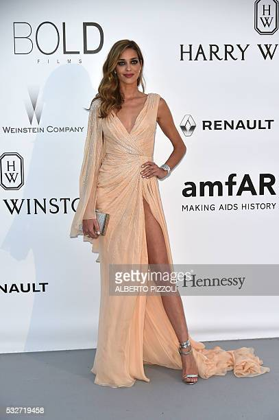 Brazilian model Ana Beatriz Barros poses as she arrives for the amfAR's 23rd Cinema Against AIDS Gala on May 19 2016 in Antibes southeastern France /...