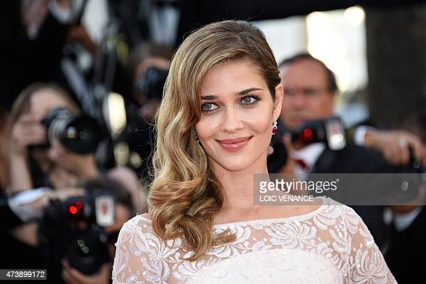Brazilian model Ana Beatriz Barros poses as she arrives for the screening of the film 'Inside Out' at the 68th Cannes Film Festival in Cannes...