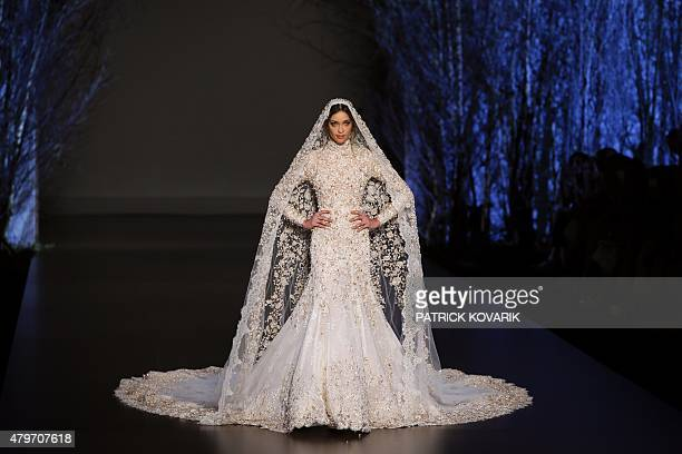 Brazilian model Ana Beatriz Barros presents a creation by RalphRusso during the 20152016 fall/winter Haute Couture collection fashion show on July 6...