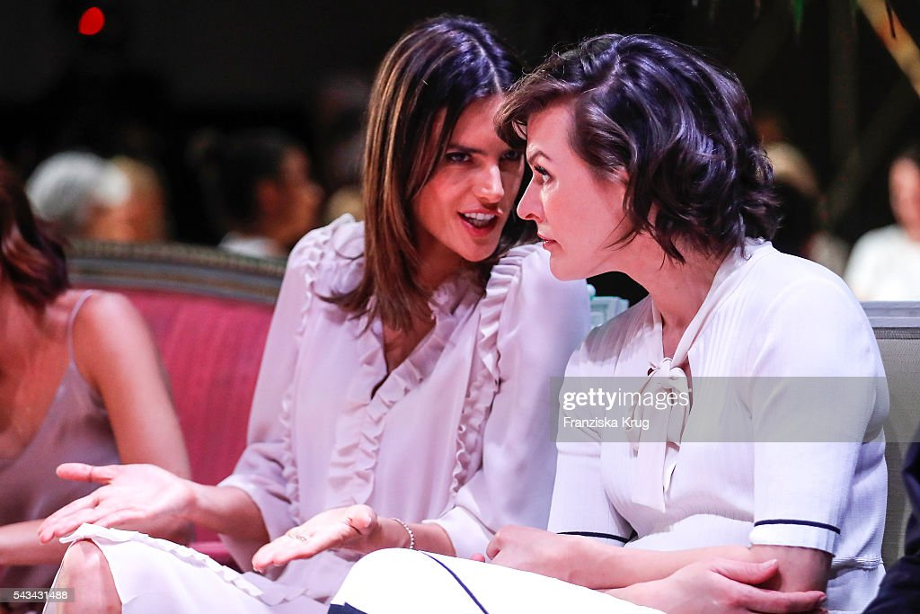 Brazilian model and actress <a gi-track='captionPersonalityLinkClicked' href=/galleries/search?phrase=Alessandra+Ambrosio&family=editorial&specificpeople=203062 ng-click='$event.stopPropagation()'>Alessandra Ambrosio</a> and US actress <a gi-track='captionPersonalityLinkClicked' href=/galleries/search?phrase=Milla+Jovovich&family=editorial&specificpeople=202207 ng-click='$event.stopPropagation()'>Milla Jovovich</a> attend the Marc Cain show spring/summer 2017 at CITY CUBE Panorama Bar on June 28, 2016 in Berlin, Germany.