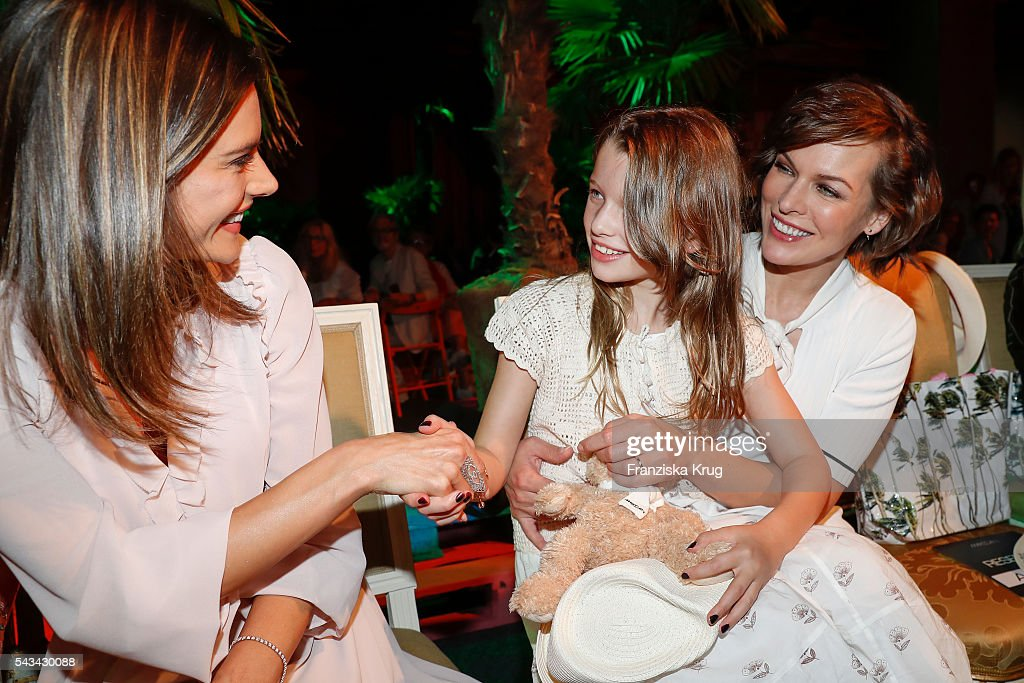Brazilian model and actress Alessandra Ambrosio, US actress Milla Jovovich and her daughter Ever Gabo attend the Marc Cain show Spring/Summer 2017 at CITY CUBE Panorama Bar on June 28, 2016 in Berlin, Germany.