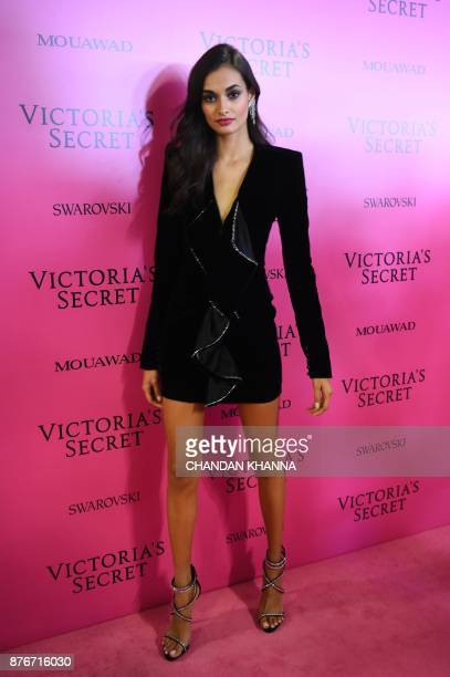 Brazilian model Gizele Oliveira poses as she arrives for the after party for the 2017 Victoria's Secret Fashion Show in Shanghai on November 20 2017...