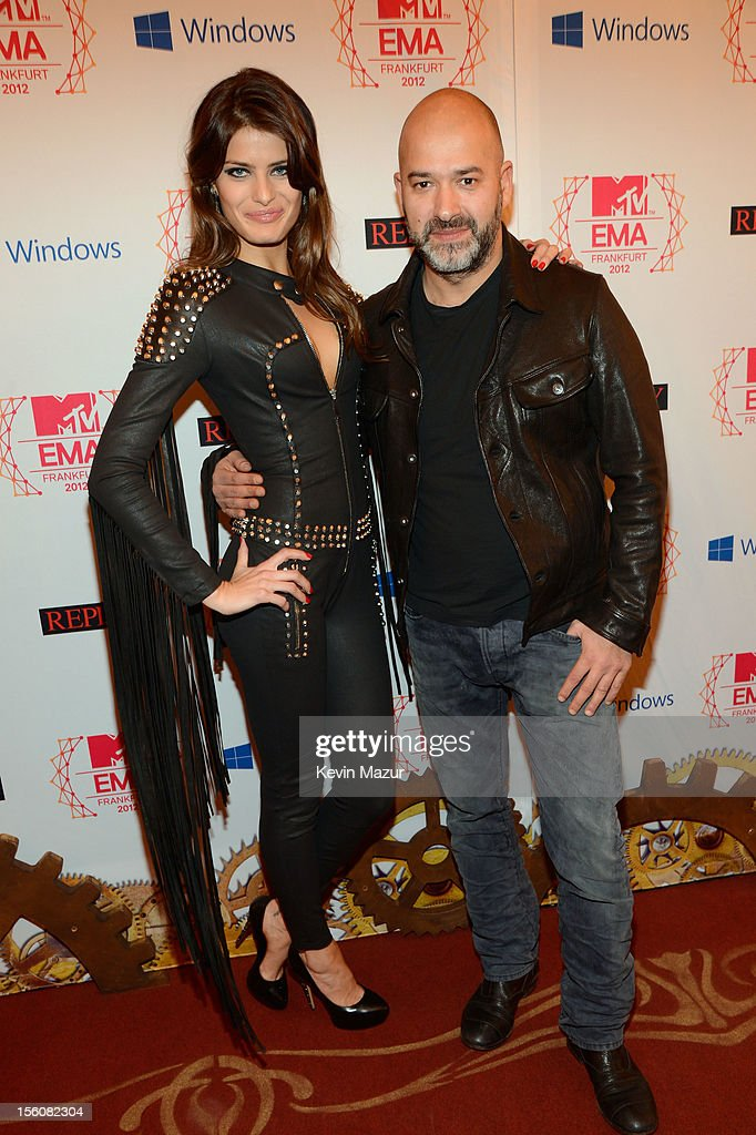 Brazilian model Isabeli Fontana (L) and Massimo Sinigaglia, CEO of Replay, attend the MTV EMA's 2012 at Festhalle Frankfurt on November 11, 2012 in Frankfurt am Main, Germany.