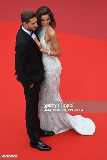 Brazilian model Izabel Goulart and German football player Kevin Trapp pose as they arrive on May 22 2017 for the screening of the film 'The Killing...