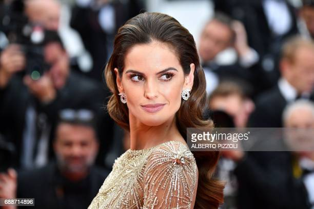 Brazilian model Izabel Goulart poses as she arrives on May 26 2017 for the screening of the film 'L'Amant Double' at the 70th edition of the Cannes...
