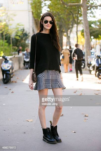 Brazilian model Kamila Hansen exits the Veronique Leroy show in RayBan sunglasses a Louis Vuitton purse and Doc Marten boots at Palais de Tokyo on...