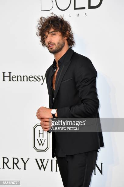 Brazilian model Marlon Teixeira poses as he arrives for the amfAR's 24th Cinema Against AIDS Gala on May 25 2017 at the Hotel du CapEdenRoc in Cap...