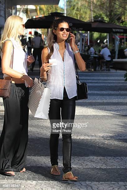 Brazilian model Raica Oliveira is seen shopping December 04 2013 in Miami Beach Florida