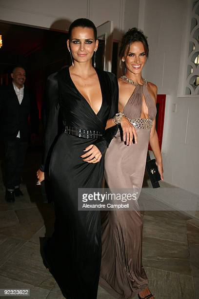 Brazilian models Fernanda Motta and Alessandra Ambrosio arrive at the 'Mario de Janeiro Testino' book launching during the opening dinner and charity...