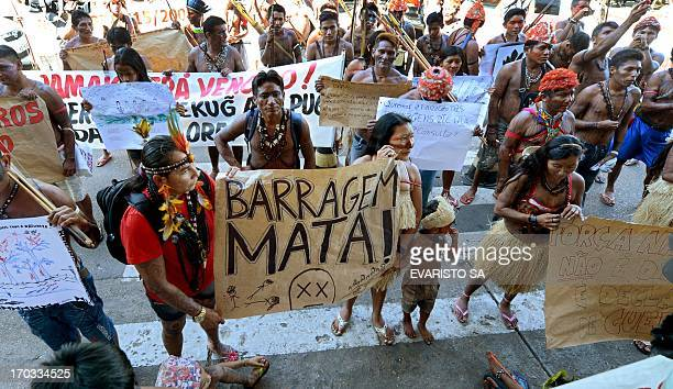 Brazilian Munduruku natives rally in front of the Ministry of Mines and Energy in Brasilia on June 11 2013 About 150 Mundurukus natives occupied...