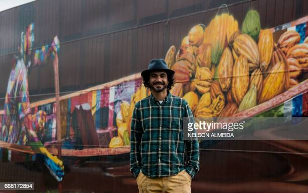 Brazilian mural artist Eduardo Kobra poses in front of his recent work the biggest mural in the world with 5742 square meters in Itapevi metropolitan...