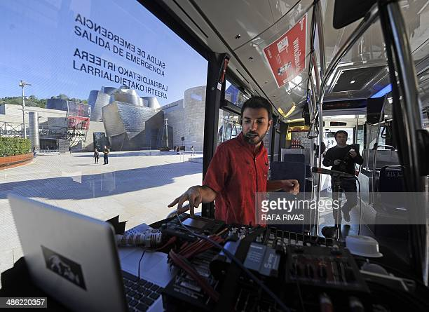 Brazilian musician Diego Ain performs in a public bus decorated with images of Brazilian artist Ernesto Neto's exhibition 'The Body that Carries Me'...