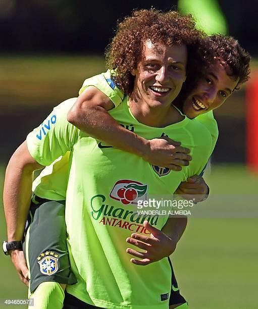 Brazilian national football team Bernard jokes with David Luiz during a training session of the Brazilian national football team at the squad's...