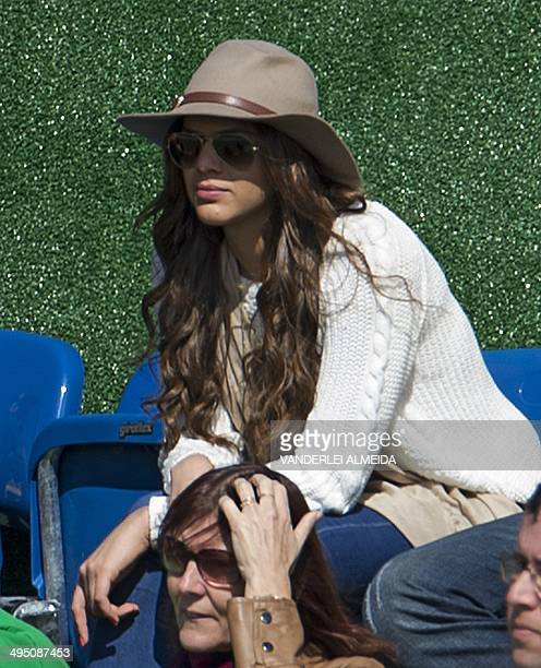 Brazilian national football team player Neymar's girlfriend Brazilian actress Bruna Marquezine looks at a training session at the squad's Granja...
