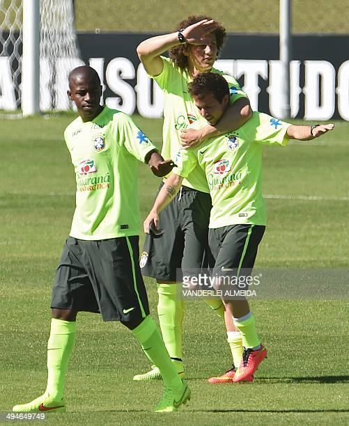 Brazilian national football team players Ramires David Luiz and Bernard take part in a training session of the Brazilian national football team at...
