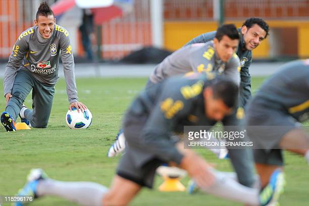 Brazilian national football teamplayer Neymar takes part in a training session at Pacaembu stadium in Sao Paulo Brazil on June 6 2011 ahead of their...