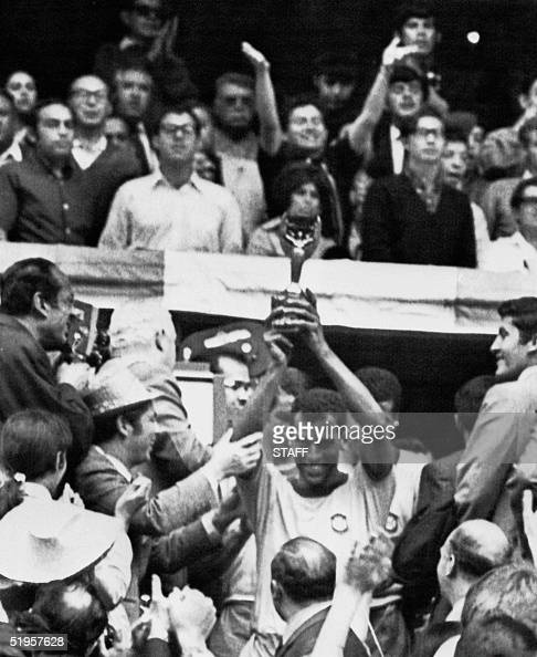 Brazilian national soccer team captain and defender Carlos Alberto smiles as he holds aloft the Jules Rimet Cup after Brazil defeated Italy 41 in the...