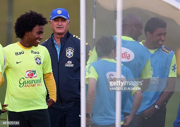 Brazilian national team coach Luiz Felipe Scolari talks to Brazil's midfielder Willian Brazil's forward Bernard Brazil's defender Maicon and Brazil's...