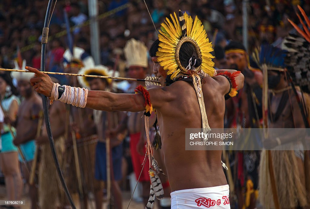 A Brazilian native from the Guarani Kaiowa ethnic group takes part in the bow and arrow competition, during the first day of the International Games of Indigenous Peoples, in Cuiaba, state of Mato Grosso, on November 10, 2013. 1500 natives from 49 Brazilian ethnic groups and from another 17 countries are gathering in Cuiaba until November 16 to compete in some 30 athletic disciplines, many of their own. AFP PHOTO / Christophe Simon