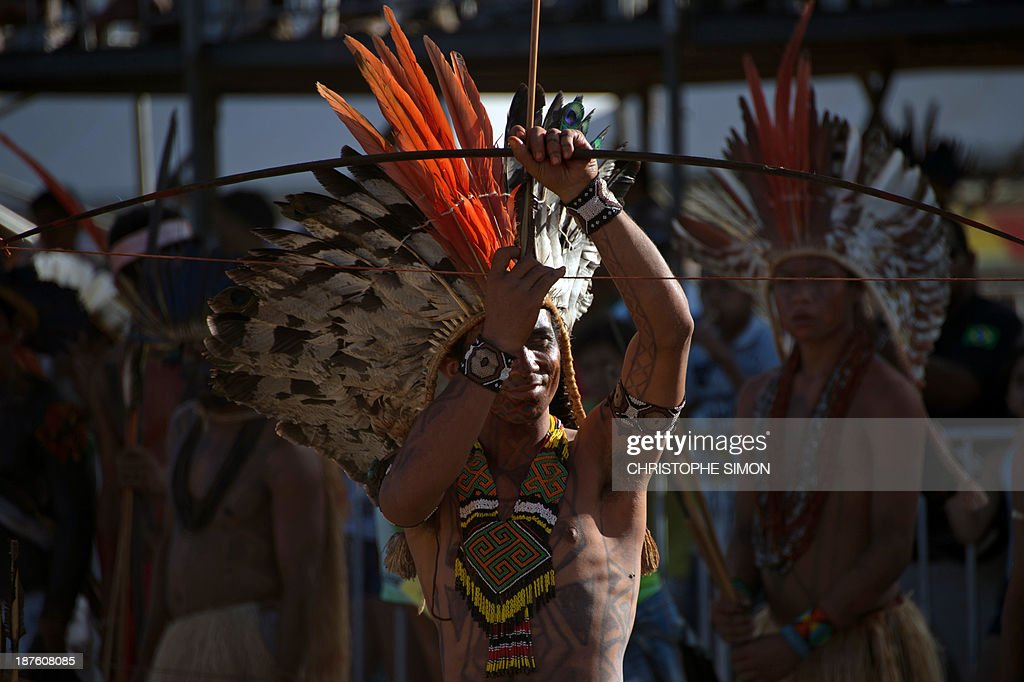 A Brazilian native from the Kuntunawa ethnic group gets ready for the bow and arrow competition, during the first day of the International Games of Indigenous Peoples, in Cuiaba, state of Mato Grosso, on November 10, 2013. 1500 natives from 49 Brazilian ethnic groups and from another 17 countries are gathering in Cuiaba until November 16 to compete in some 30 athletic disciplines, many of their own. AFP PHOTO / Christophe Simon