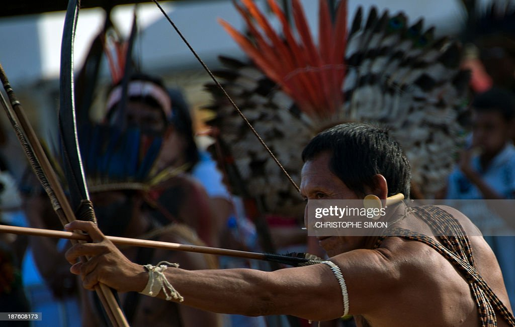 A Brazilian native from the Matis ethnic group takes part in the bow and arrow competition, during the first day of the International Games of Indigenous Peoples, in Cuiaba, state of Mato Grosso, on November 10, 2013. 1500 natives from 49 Brazilian ethnic groups and from another 17 countries are gathering in Cuiaba until November 16 to compete in some 30 athletic disciplines, many of their own. AFP PHOTO / Christophe Simon