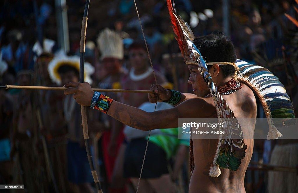 A Brazilian native from the Sahanenawa ethnic group takes part in the bow and arrow competition, during the first day of the International Games of Indigenous Peoples, in Cuiaba, state of Mato Grosso, on November 10, 2013. 1500 natives from 49 Brazilian ethnic groups and from another 17 countries are gathering in Cuiaba until November 16 to compete in some 30 athletic disciplines, many of their own. AFP PHOTO / Christophe Simon