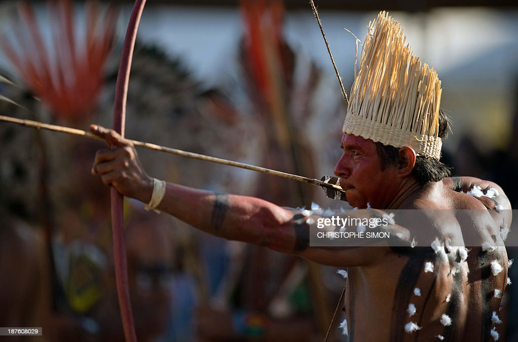 A Brazilian native from the Xerente ethnic group takes part in the bow and arrow competition, during the first day of the International Games of Indigenous Peoples, in Cuiaba, state of Mato Grosso, on November 10, 2013. 1500 natives from 49 Brazilian ethnic groups and from another 17 countries are gathering in Cuiaba until November 16 to compete in some 30 athletic disciplines, many of their own. AFP PHOTO / Christophe Simon