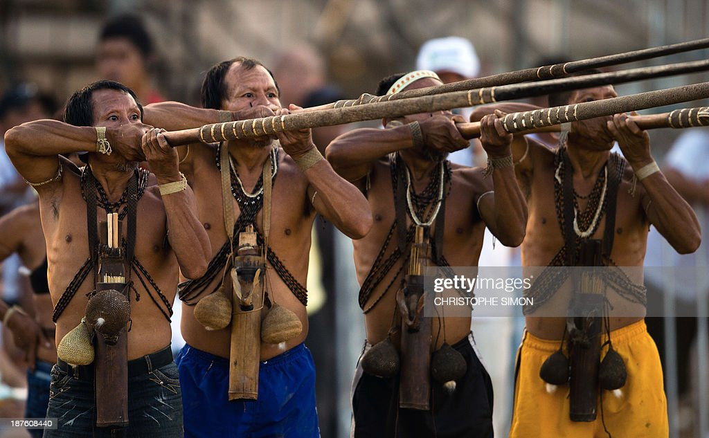 Brazilian natives of the Matis tribe take part in a blowpipe event, during the first day of the International Games of Indigenous Peoples, in Cuiaba, state of Mato Grosso, on November 10, 2013. 1500 natives from 49 Brazilian ethnic groups and from another 17 countries are gathering in Cuiaba until November 16 to compete in some 30 athletic disciplines, many of their own. AFP PHOTO / Christophe Simon