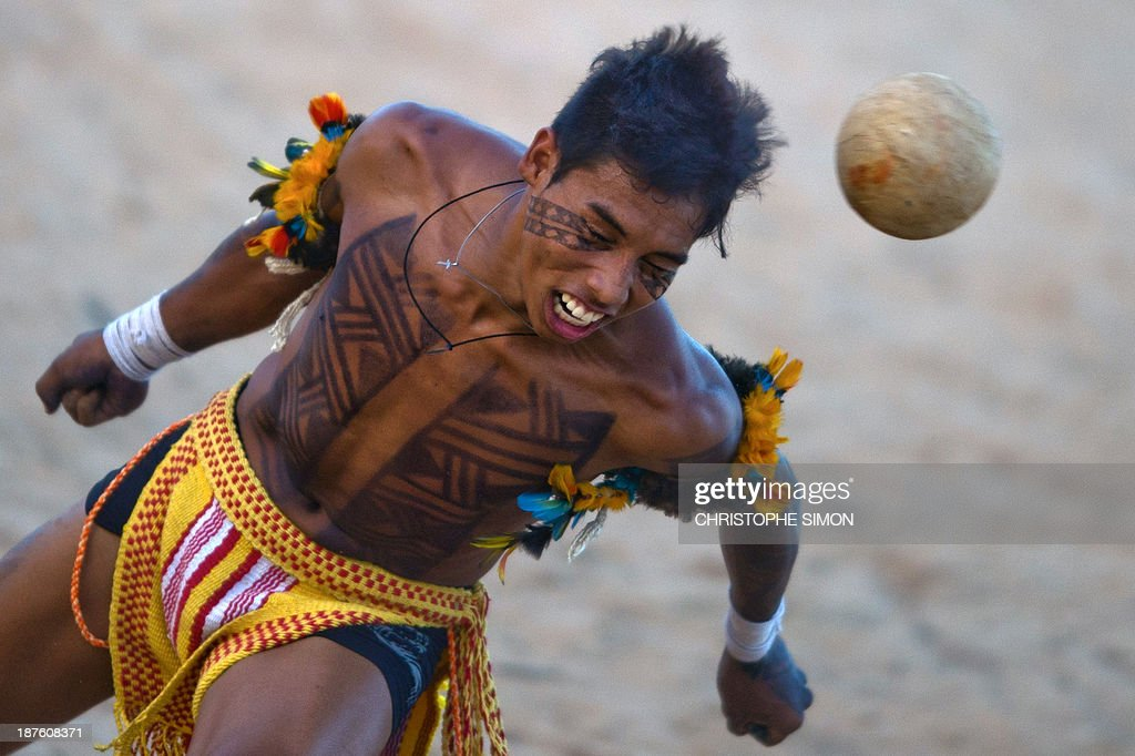 Brazilian natives of the Pareci tribe play head football with a hand-made ball for a demonstration, during the first day of the International Games of Indigenous Peoples, in Cuiaba, state of Mato Grosso, on November 10, 2013. 1500 natives from 49 Brazilian ethnic groups and from another 17 countries are gathering in Cuiaba until November 16 to compete in some 30 athletic disciplines, many of their own. AFP PHOTO / Christophe Simon