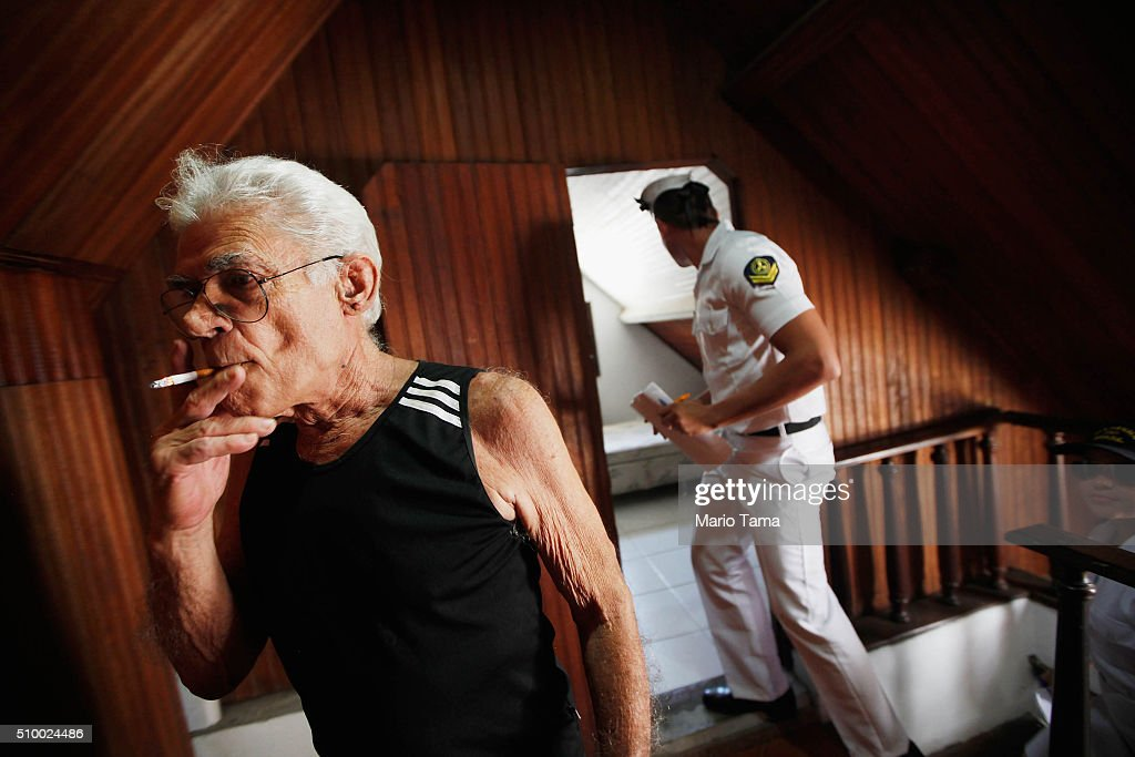 A Brazilian Navy sailor (R) inspects a man's home while passing out pamphlets warning of the dangers of the Zika virus and how to protect against mosquitos on February 13, 2016 in Rio de Janeiro, Brazil. 220,000 Brazilian military troops were deployed today in a mobilization across country to warn of the dangers of the mosquito-borne virus which may be linked to microcephaly.